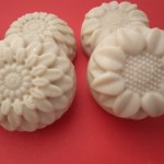 image of a white bar of soap made with sea salt in a flower soap mold